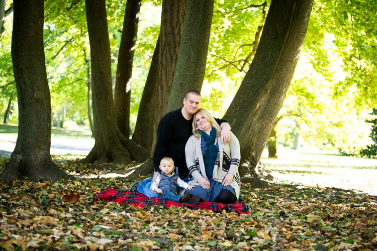 Family and child portrait taken in the woods at Delaware Park.